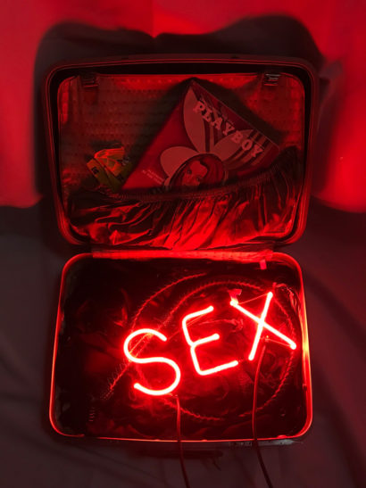 INDIRA-CESARINE_SEX-in-a-Suitcase_NEON-SCULPTURE-with-Vintage-Leather-Suitcase-Lingerie-Leather-Whip-June-1970-Issue-of-Playboy_2018-v2-lr.jpg